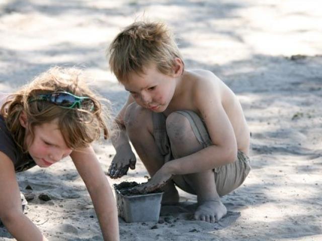 Kids playing in the Kalahari sand, Savute, Chobe National Park, Botswana