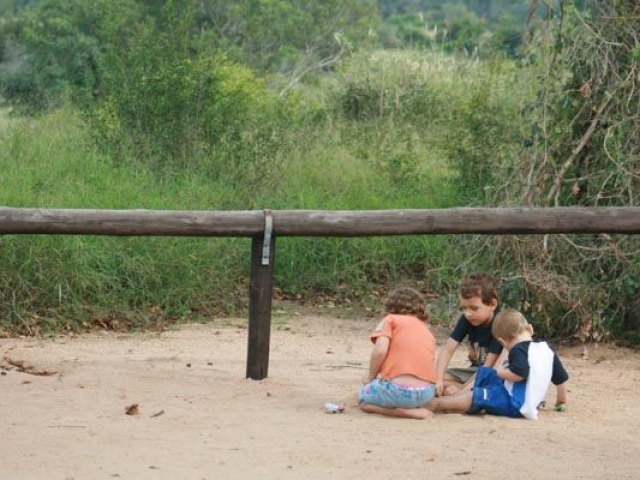 The kids playing on the sand at a Picnic Site near Satara, Kruger National Park