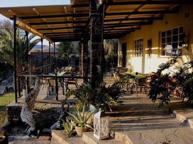 Zebra River Lodge verandah and garden restaurant