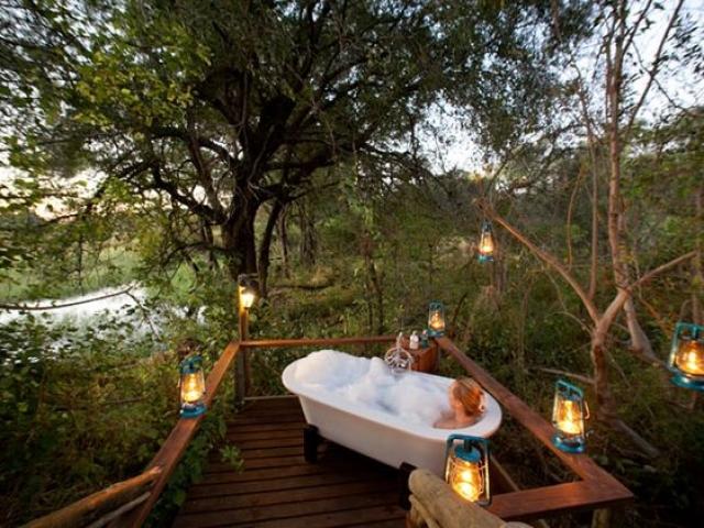 Pom Pom Camp, open air bath time, Botswana and Zimbabwe