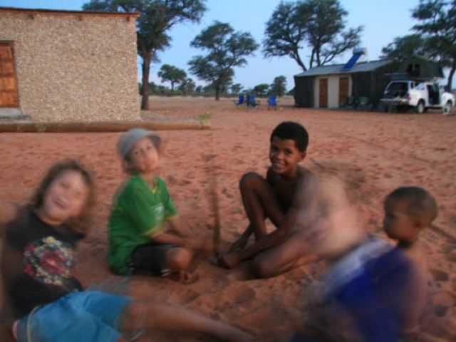 Playing in the sand with the #Khomani San in the Kalahari, South Africa