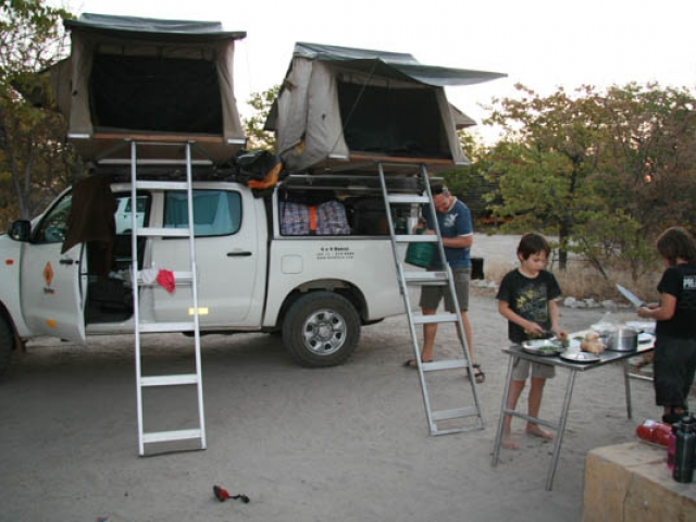 Camp cooking, Planet Baobab, Botswana - they always seem to help more when we are travelling than at home!