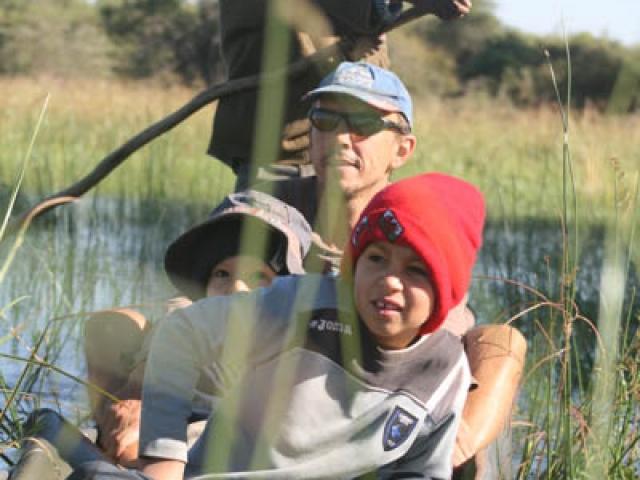 On a mekoro in the Okavango Delta, Botswana