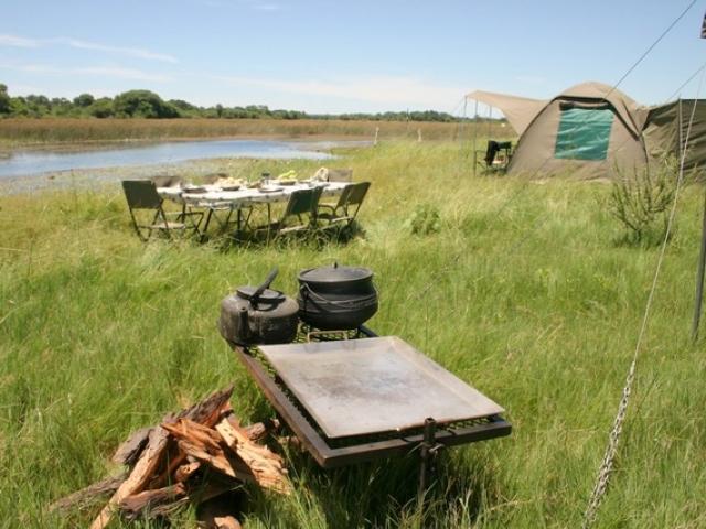 Essential Botswana, private campsite along the Khwai River
