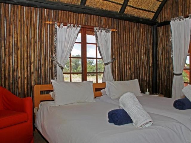 Namibia Wonders - Intu Africa Camelthorn Lodge - Bedroom, Kalahari (Standard)