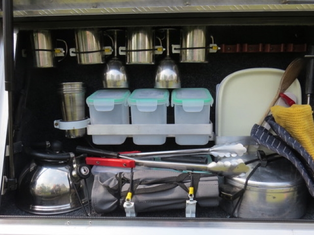 All the cooking and eating equipment needed to be self-sufficient on the road - fully equipped camping 4x4 vehicle.