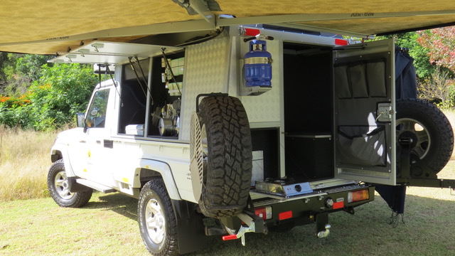 Bushcamper fully equipped camping 4x4 Landcruiser vehicle - plenty of storage space in the rear canopy.
