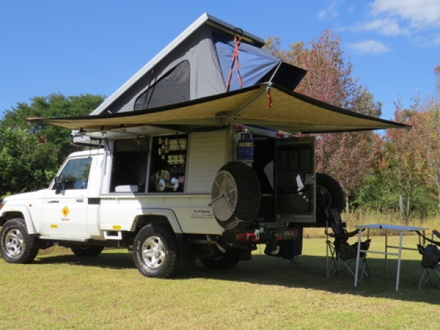 Bushcamper fully equipped camping 4x4 Landcruiser vehicle - wrap around canopy provides shade where ever you are.