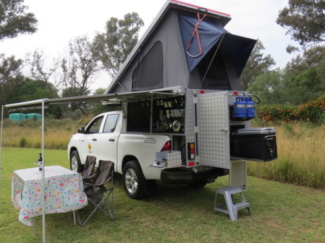 Bushcamper fully equipped camping 4x4 vehicle - roof top tent sets up in seconds